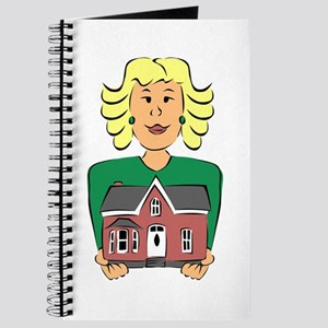 Real estate agent holding house Journal