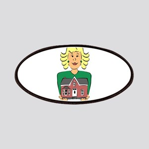 Real estate agent holding house Patch
