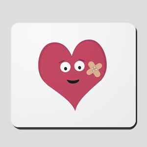 Heart face with patch Mousepad
