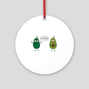 crazy avocado undresses Round Ornament
