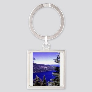 very blue lake Tahoe with evergreen tree Keychains