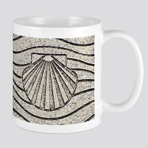 El Camino shell, pavement, Spain Mugs
