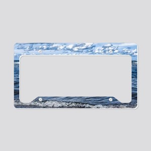 Cloudy day on the beach License Plate Holder