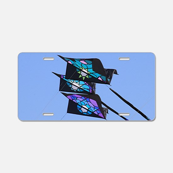 Three kites flying in sky Aluminum License Plate