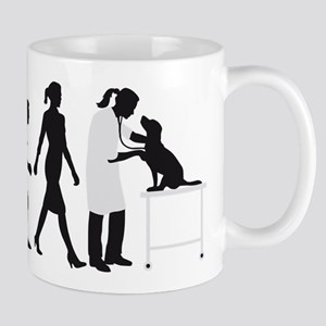 evolution of man female veterinarian Mugs