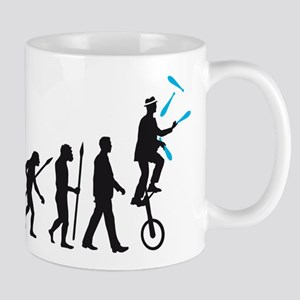 evolution of man juggler Mugs
