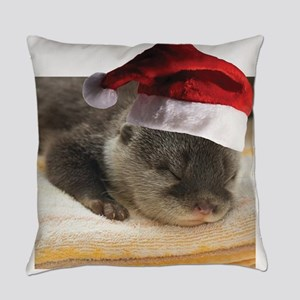 A Cute Sleepy Otter wearing a Sant Everyday Pillow