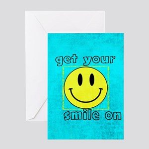 smiley says GET YOUR SMILE ON Greeting Cards