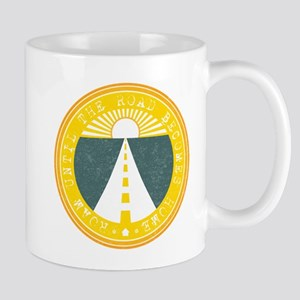 roam until the road becomes home Mugs