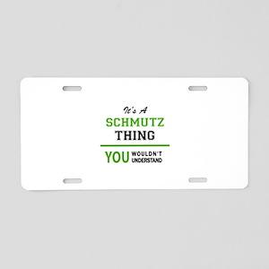 It's SCHMUTZ thing, you wou Aluminum License Plate