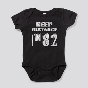 Keep Distance I am 82 Baby Bodysuit