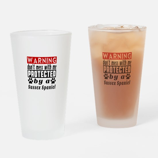 Protected By Sussex Spaniel Drinking Glass