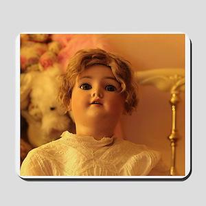 antique porcelain bisque doll looking up Mousepad