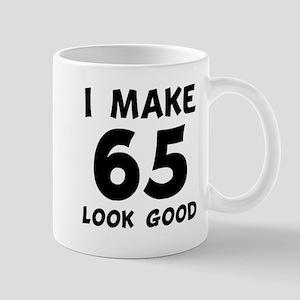 I Make 65 Look Good Mugs