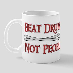 Beat Drums Not People Mug