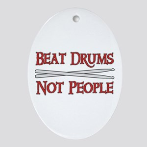 Beat Drums Not People Oval Ornament