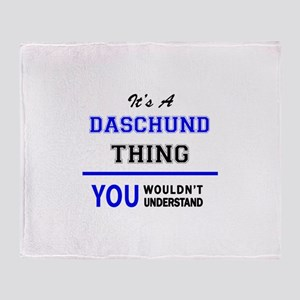 It's a DASCHUND thing, you wouldn't Throw Blanket