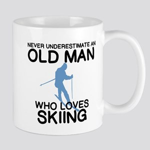 SNOW SKIING. NEVER UNDERESTIMATE AN OLD MAN Mugs
