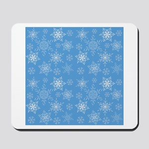 Glittery Snowflakes over Blue Background Mousepad