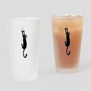 Black Cat Hanging On Drinking Glass