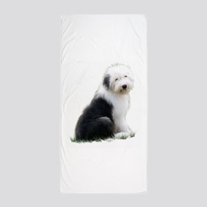 old english sheepdog puppy sitting Beach Towel