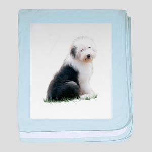 old english sheepdog puppy sitting baby blanket