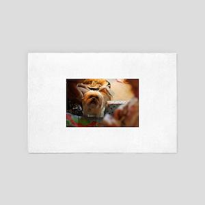 Koko blond Lhasa apso among gift wrap 4' x 6' Rug