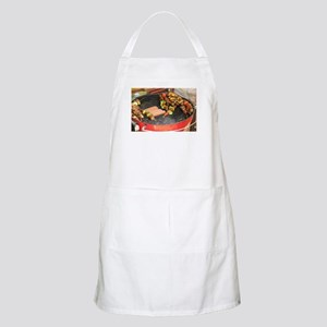 barbeque grill with with hot dogs and Light Apron