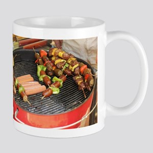 barbeque grill with with hot dogs and sausage Mugs