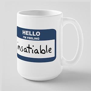 Feeling insatiable Mugs