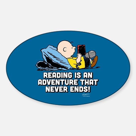 Charlie Brown - Reading is an Adven Sticker (Oval)