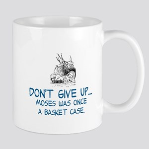 DON'T GIVE UP, MOSES WAS ONCE A BASKET Large Mugs