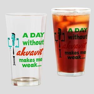 A day without Akvavit makes me weak Drinking Glass