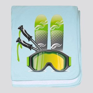 Skiing skies goggles and sticks baby blanket