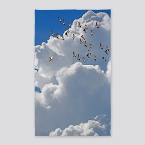Birds in flight Area Rug