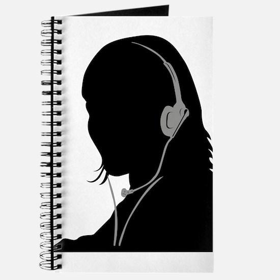 Call center operator with headphones Journal
