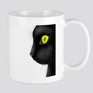 Black cat face with bright eye Mugs