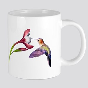 Hummingbird in flight Mugs