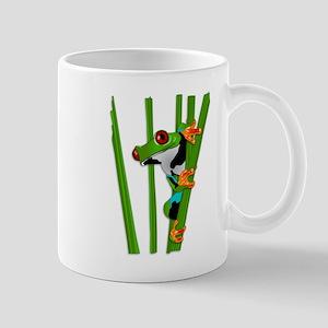 Cute frog on grass Mugs