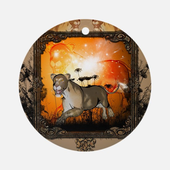 Lioness in a frame Round Ornament