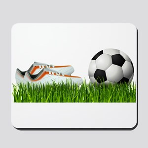 Orange soccer shoes with football Mousepad