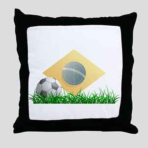 Soccer ball on grass field Throw Pillow