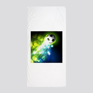 Glowing soccer ball on abstract backgr Beach Towel