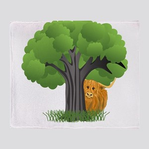 Woolly Moo behind tree Throw Blanket