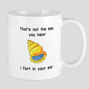 Sea shell in your ear Mugs