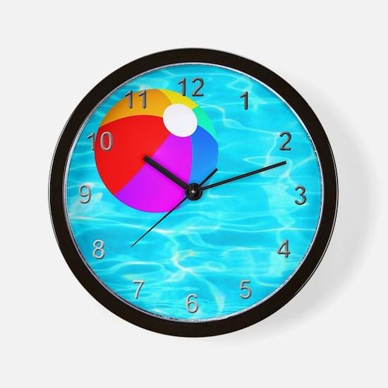 Beach Ball in Pool Wall Clock