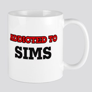 Addicted to Sims Mugs