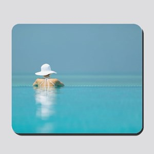 Woman in a sun hat looking out to sea fr Mousepad