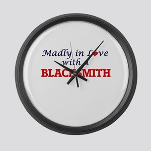 Madly in love with a Blacksmith Large Wall Clock