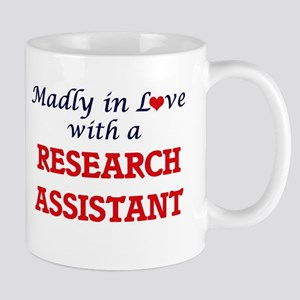 Madly in love with a Research Assistant Mugs
